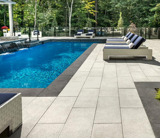 Pool side view of landscape stones we supply to clientss