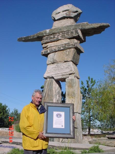 Allstone founder standing infront of world record settingInukshuk